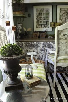 Grab your gardening containers and add whimsical garden elements like tiny bird cages to create a room of interest. What makes a room a knock out? Its the attention to detail in accessorizing after you nail your basics down.   Mixing up a pattern with a graphic design, like stripes with toile or floral, chosen within your color palette will elevate the style quotient in the room. Have fun, and make it yours, by thinking outside the box when you decorate with a theme. Sponsored by HomeGoods.