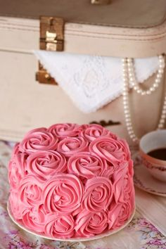 shabby cake, fab idea for vintage themed wedding cake - pink icing 'roses', and stylish 'shabby chic' setting Repinned by www.silver-and-grey.com