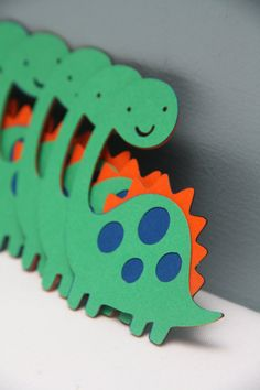 This is another Crafting Crew product with a story!! I (Ashley) have a son, Avery, that LOVES dinosaurs. Anything and everything dinosaurs. He cant get enough of them. This is one of Averys favorite dinosaurs and he asks me to make them for him all the time.  This is an orange, green and blue dinosaur diecut. Dinosaur measures approximately 4 tall.  This would be perfect for the Avery in your life. Any dinosaur lover would love to have these!!  Other sizes, quantities and colors are…