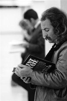 """David Crosby, San Francisco, CA 1969  © Graham Nash, 1969  """"Croz at the San Francisco International Airport reading some light material, 1969."""""""