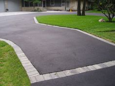Spruce up an asphalt driveway with a paver edge!