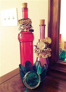Use vintage bottles to display bracelets and watches.