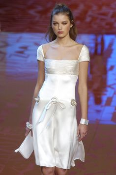 Valentino. LOVE the top and the sleeves. Without the hole and tie in the middle.