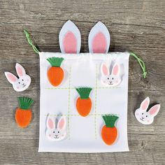 Easter Tic Tac Toe Game Pieces stay together in the 8 x cotton/polyester bag with game board on front, drawstring closure, and ears! Also includes 4 felt carrot and 4 felt bunny playing pieces. Easter Games, Easter Crafts For Kids, Easter Art, Easter Activities, Easter Ideas, Craft Stick Crafts, Felt Crafts, Diy Crafts, Craft Ideas