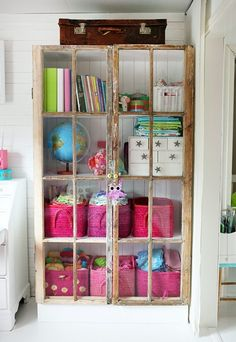 cute and colorful organization in a vintage shabby cupboard