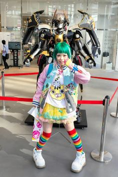 "Always-kawaii Harajuku girl (and Kera Magazine model) Kurebayashi Haruka vs. a mecha from ""Nobunaga the Fool"" on the street in Shibuya today. We are always happy to run into Kurebayashi because she's actually as fun/happy/energetic as she looks. (Tokyo Fashion, 2014)"