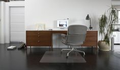 House Tour: Andreas' Greektown Loft. Andeas' beloved Florence Knoll desk with an Eames Time Life chair.