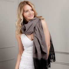 Made from soft cotton, this Mexican rebozo is perfect as a scarf, pashmina or wrap. Great  for people who want to look chic, while knowing how and where their clothes are made. This rebozo is made in a traditional ikat pattern in pink with black accents.  It looks and feels luxurious and elegant, but it can also be worn to brighten up any outfit. Perfect for unpredictable weather!