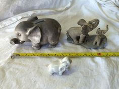 Ceramic Elephant Piggy bank and two other elephant figures.