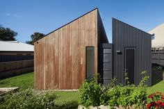 The contrasting materials and varying roof heights add visual interest while complementing one another.