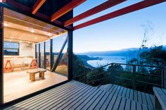 """A low-cost """"surf shack"""" cabin overlooking the ocean in Chile. Shared by two brothers, it has two small bedrooms in 555 sq ft. 