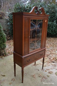 "Girl finds china cabinet at the thrift store for only $40. Girl uses an easy, no sanding and no priming furniture paint called Beyond Paint in ""Nantucket"" blue to create a pretty blue china cabinet makeover. Girl loves the ""AFTER""!"