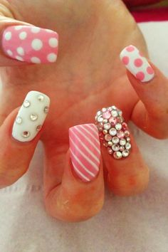 pink and white manicure with stripes, dots and bling