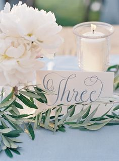 dusty blue calligraphy and olive branches
