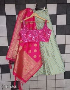 Lehengas Trendy Women's Lehenga Topwear Fabric: Silk Bottom Fabric : Heavy Banarasi Jacquard Dupatta Fabric : Banarasi Jacquard Set type: Choli And Dupatta Top Print or Pattern Type: Embellished Sizes:  Semi Stitched (Lehenga Waist Size: 38 in Lehenga Length Size: 42 in Flair Size : 2.5 m  Blouse Size : Free size (Up to 40 in) Dupatta Length Size: 2.25 m)  Semi Stitched (Lehenga Waist Size: 40 in Lehenga Length Size: 42 in Blouse Size : Free size (Up to 40 in) Dupatta Length Size: 2.25 m) Country of Origin: India Sizes Available: Semi Stitched   Catalog Rating: ★4.3 (468)  Catalog Name: Classy Stylish Banarasi Jacquard Silk Women's Lehenga Vol 14 CatalogID_1823060 C74-SC1005 Code: 1231-11428505-