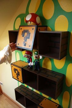 You gotta be kidding me!!  Nintendo themed bookcase and mural