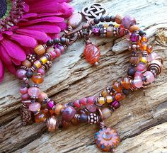 The Cerebral Dilettante. I'd wear this! Components include copper, Czech glass & Indonesian glass beads from Happy Mango Beads.