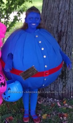 Cool Violet from Willy Wonka Costume (paper maiche on a yoga ball--cut out holes....table cloth, buttons, stocking and blue paint.