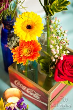 Vintage aqua and red wedding. Wood coke crate center pieces. Colorful flowers. Vintage soda bottles.