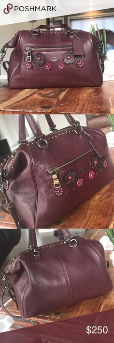 Coach wine leather floral tea rose handbag Beautiful shade of deep wine red. Gorgeous detailing. I only carried this bag briefly & I handle them very carefully due to its value. Has it's dust bag. Removeable Long adjustable strap. Purchased this myself from Dillards. Measures 15 x 10 x 4.5. Edges look good. Inside clean. Bundling is fun; check out my other items & save! Home is smoke free/ cat friendly. Plz, no price talk in comments. No trades or holds. Coach Bags Satchels