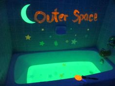 Space Bath with glow-in-the-dark paint and glow sticks. Awesome