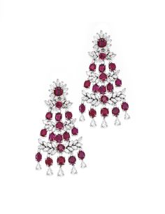PAIR OF PLATINUM, RUBY AND DIAMOND EARCLIPS. Of chandelier design, set with 30 round and cushion-cut rubies, accented by numerous round, pear and marquise-shaped diamonds set in foliate motifs weighing approximately 11.45 carats, gross weight approximately 25 dwts.