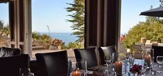 Oraukawa Lodge table setting with sea views