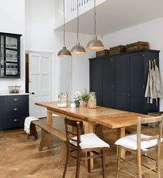 A bank of four deVOL pantry cupboards, sat against the back wall of this beautiful room. They are big deep cupboards, housing a full height fridge and freezer and two pantries, yet in this kitchen they were quietly understated yet perfectly proportioned. #deVOLKitchens