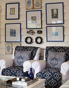 Matching throws bring classic nautical color to a pair of white slipcovered chairs