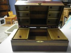 the inside, loaded with compartments and 6 turned purple heart vials for sewing needles.