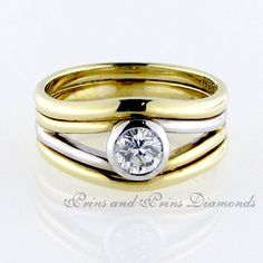 Centre stone is a 0.47ct J – K/VS round brilliant cut diamond set in a tube in an 18k yellow and white gold split band ring