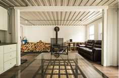 Joseph-Dupuis-shipping-container-home-wood-burning-stove.jpg
