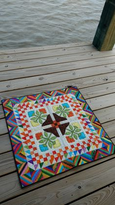 My version of Quiltville's Bonnie Hunter's Spanish Rose Table Topper. I turned needle the applique and finished the applique with an embroidered blanket stitch using silk floss from my vintage thread collection. I then hand quilted the entire topper. Thoroughly enjoyed making this. http://quiltville.blogspot.com/2016/08/spanish-rose-update.html