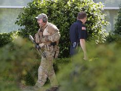 Police officers walks around the perimeter of the Curtis Culwell Center in Garland, Texas. A contest for cartoons depictions of the Prophet Muhammad in the Dallas suburb is on lockdown after authorities reported a shooting outside the building.  Gregory Castillo, The Dallas Morning News via AP
