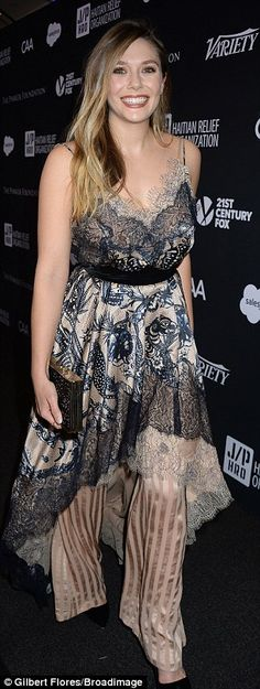 Elizabeth Olsen showcased her stunning figure in a feminine frill and lace gown