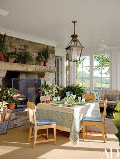 Munder-Skiles chairs accompany a skirted table on the ground-floor glazed porch.