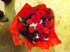 A Dozen Christmas themed Roses