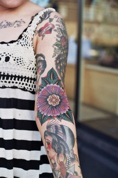 nothing is more beautiful than a beautiful flower tattoo and an arm full of traditional ink.