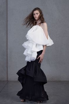 Designer Toni Maticevski has mastered the art of casual drama. It's an absolute oxymoron, I know. But how else would you describe the Sydney based designer's knack for creating the most theatrical silhouettes, with large ruffles and high volumes - but yet, convincing us that most of his