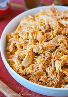 Slow-Cooker Pulled Buffalo Chicken - so simple to prepare and super delicious.  Great in sandwiches, on pizza, in dips and many other recipes!