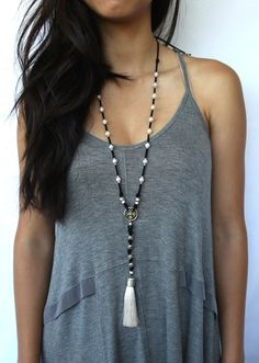 Luxe Cream Pearls delicately hanging on black ultra microfiber suede with silver bead accents. Necklace features a beautiful cross pendant and cream silk tassel. Adjustable length. Length: Adjustable