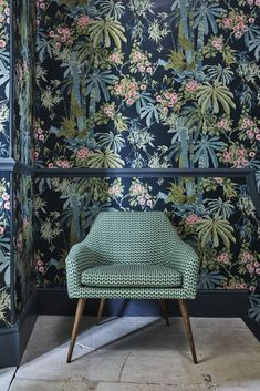 An oriental inspired bamboo forest wallpaper design, with pretty blossom flowers and a pleasing vertical pattern.