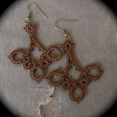 tatted earrings. I like the alternating sizes of rings in this particular version. Looks like each small ring is about half the # of stitches of the larger, picoted rings.