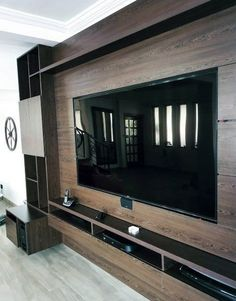 Transform your living room entertainment space with the top 70 best TV wall ideas. Explore cool television displays and wall design inspiration. Deco Tv, Tv Wanddekor, Tv Wall Cabinets, Black Cabinets, Bedroom Tv Wall, Master Bedroom, Men Bedroom, Modern Tv Wall Units, Modern Wall