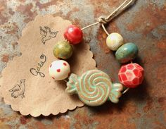 Candy. Handmade ceramic holiday bead set. Gaea handmade ceramic design elements and adornments! | gaea.cc