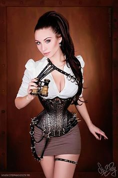 "Steampunk sexy fashion with leather crossed straps at the shoulder & fancy leather bustier with spikes over a short skirt with a gun thigh holster. She is a beauty but cannot help to wonder if some ""Photoshop"" made her waist so small! Looks like we might have a Steampunk Barbie."