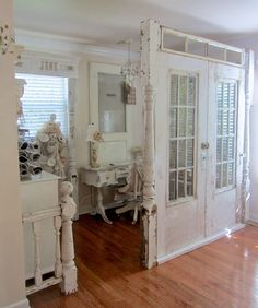 Junk Chic Cottage--old doors, post, and window to make a room divide