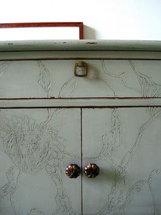 use a dremel or chisel to carve a pattern into the surface before painting. genius.