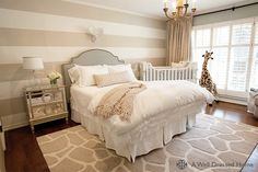 A Well Dressed Home - nurseries - Melissa & Doug Plush Giraffe, nursery guest room, guest room nursery, striped walls, striped nursery walls...