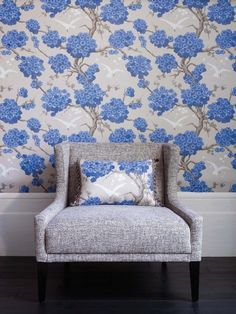 Japonerie (W6590-01) - Osborne and Little Wallpapers - An elegant all over wallpaper design, featuring trailing oriental blossom with birds in full flight. Shown here in  sapphire, ivory and stone. Other colourways are available. Please request a sample for a true colour match. Pattern repeat 64cm. Wide  width.